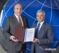 Iridium CEO Matt Desch receives the Letter of Compliance for Iridium to provide GMDSS services from Captain Moin Ahmed, director general of the International Mobile Satellite Organization