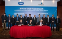 Signing the agreement are Yang Guobing, CSSC Electronics Technology, Ma Yunxiang, CSSC, and Stephan Kuhn, Wärtsilä Marine Solutions