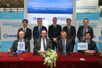 Claes Skat Roerdam and Christian Ottosen, Hempel, with Tor Svensen  and Vincent Li, DNV GL, at the contract signing at Marintec 2015 in Shanghai
